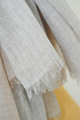 Quality cashmere scarves have a very fine weave