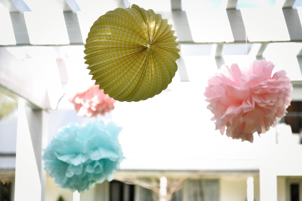 Pom poms hanging at Magpie Style