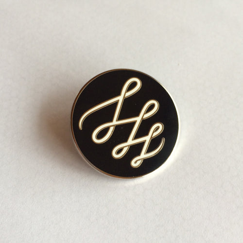 Descendant enamel badge