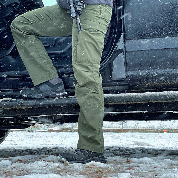 Thea wearing her U.S. Elite Exclusive Sua Sponte Mark III boots whose Gore-Tex liner will keep her feet dry even in snowy conditions