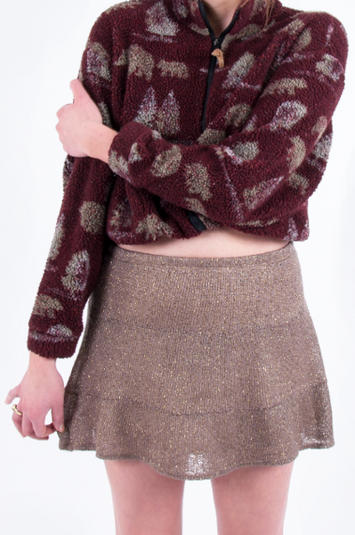 fleece jacket and glitter skirt