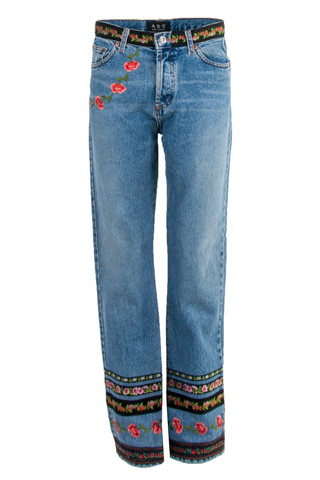 Front view of American made vintage classic blue high-rise straight leg jeans featuring patched floral print at leg opening and waist with patches at front and back pocket.