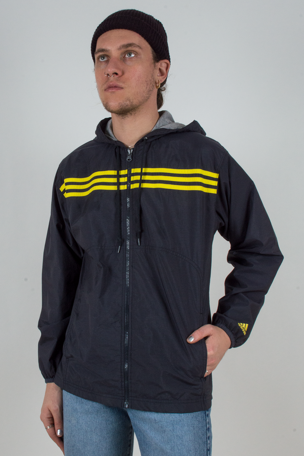 vintage navy blue Adidas track jacket with yellow stripes