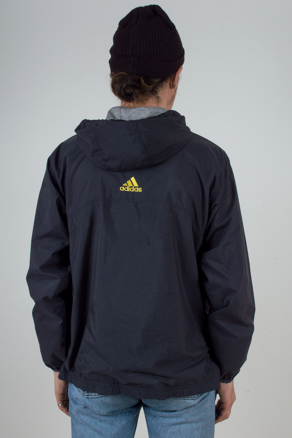 vintage navy blue Adidas track jacket with yellow logo