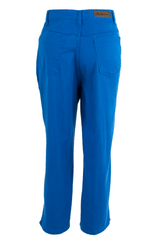 Back view of vintage high-waist electric blue jeans featuring cropped leg with hem slits, front button zip closure, and 5-pocket construction.