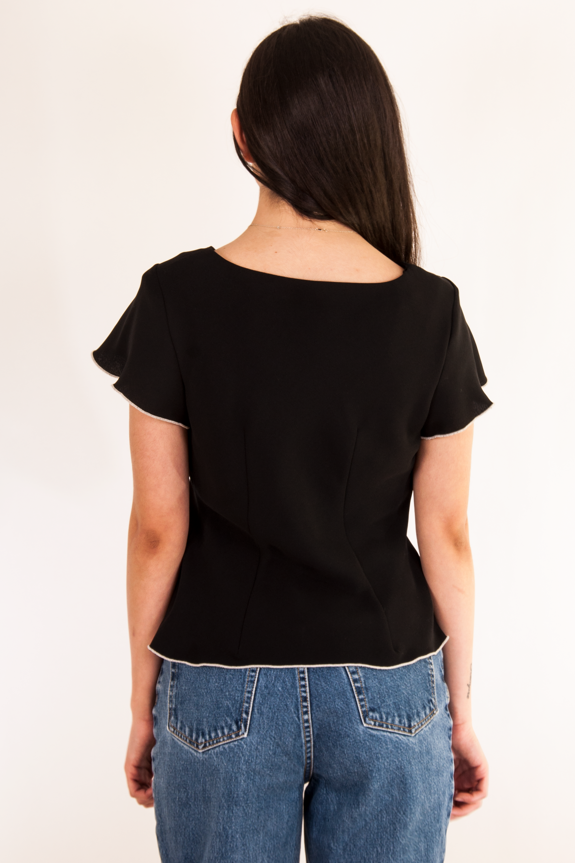 black vintage v-neck top with white trim