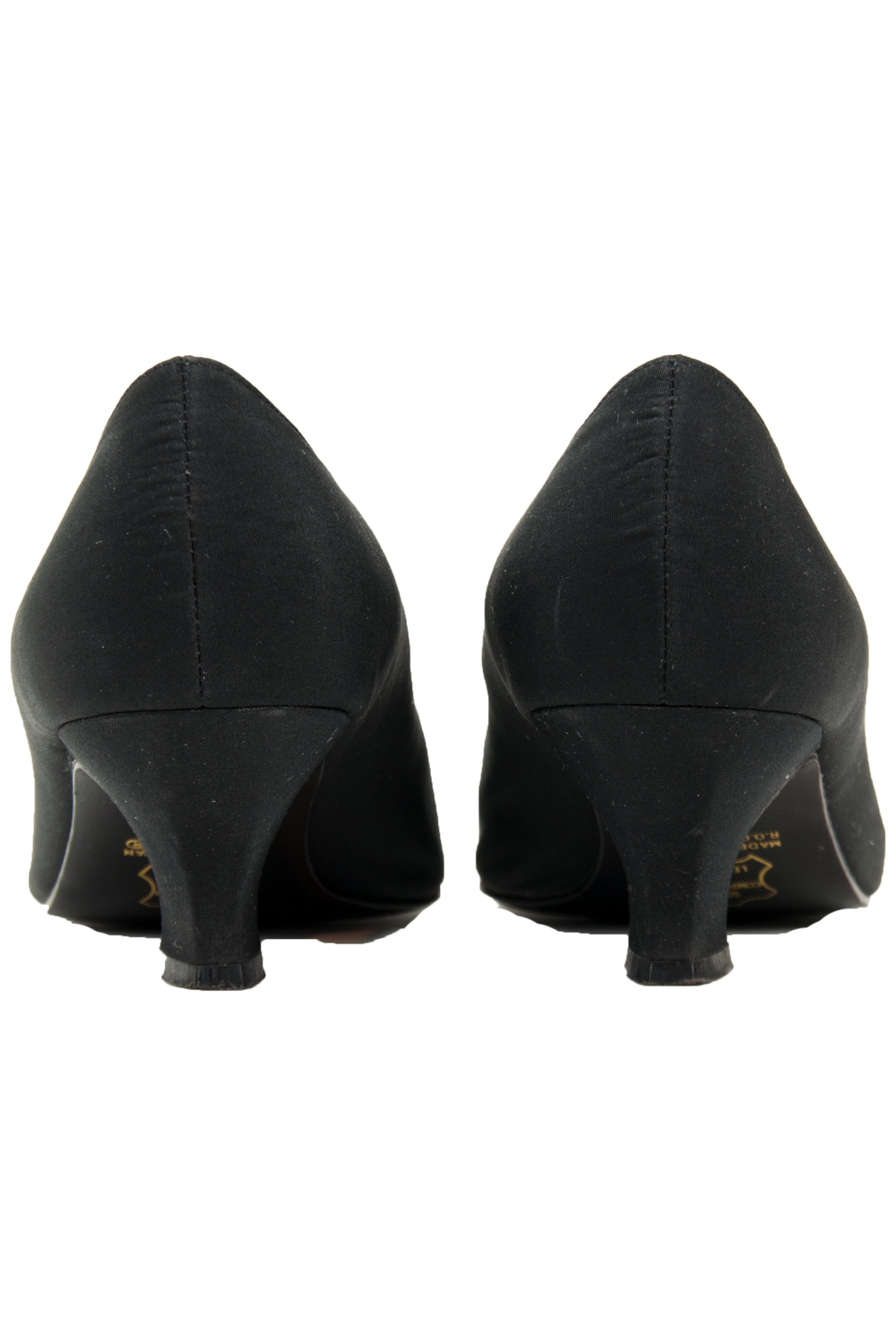 Vintage black kitten heels with scalloped edge - back view.