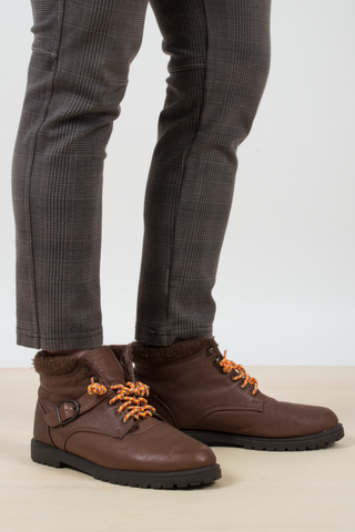 vintage brown hiking boots with orange laces