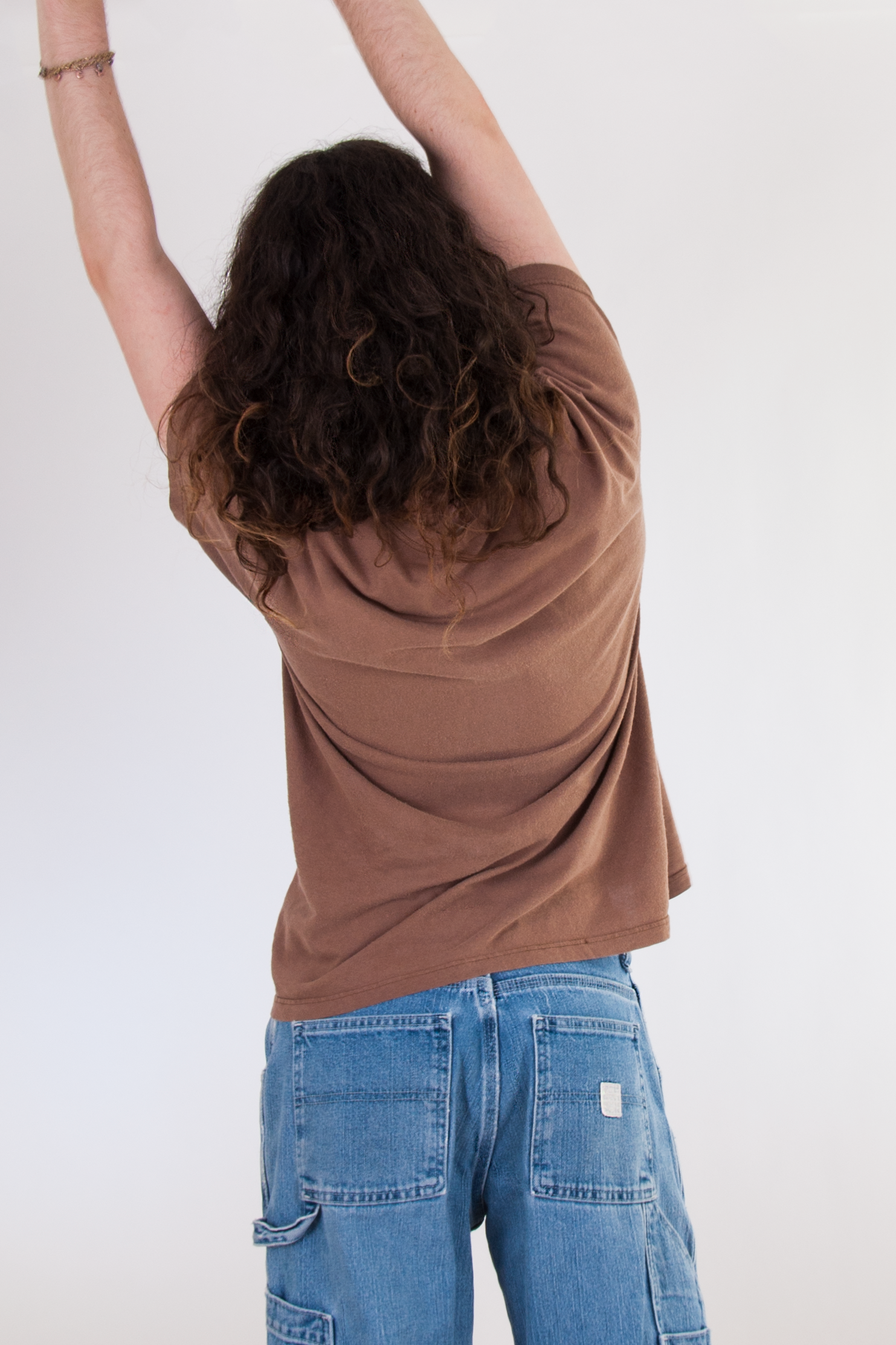 vintage brown t-shirt and retro utility jeans