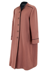 brown wool coat with black trim and front button closure