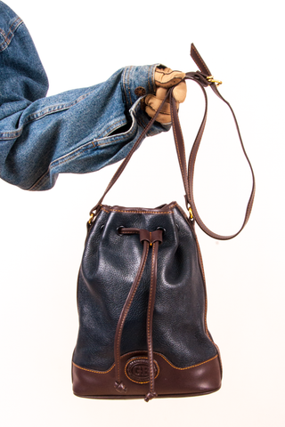 navy blue and brown vintage bucket bag with cross-body strap
