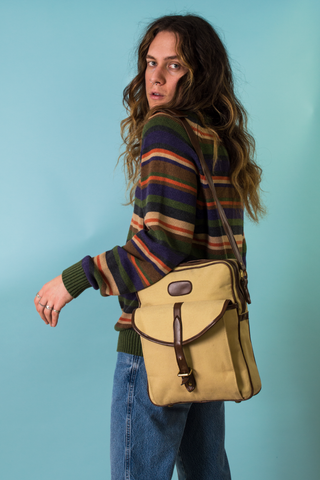 vintage sweater and canvas messenger bag