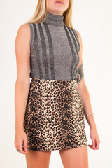 vintage cheetah mini skirt with metallic turtleneck
