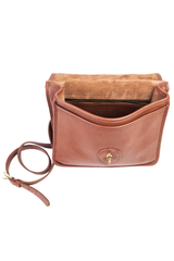 interior view of vintage coach purse in brown leather