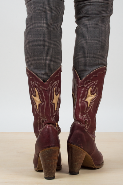 vintage burgundy leather cowboy boots in a size 7.5
