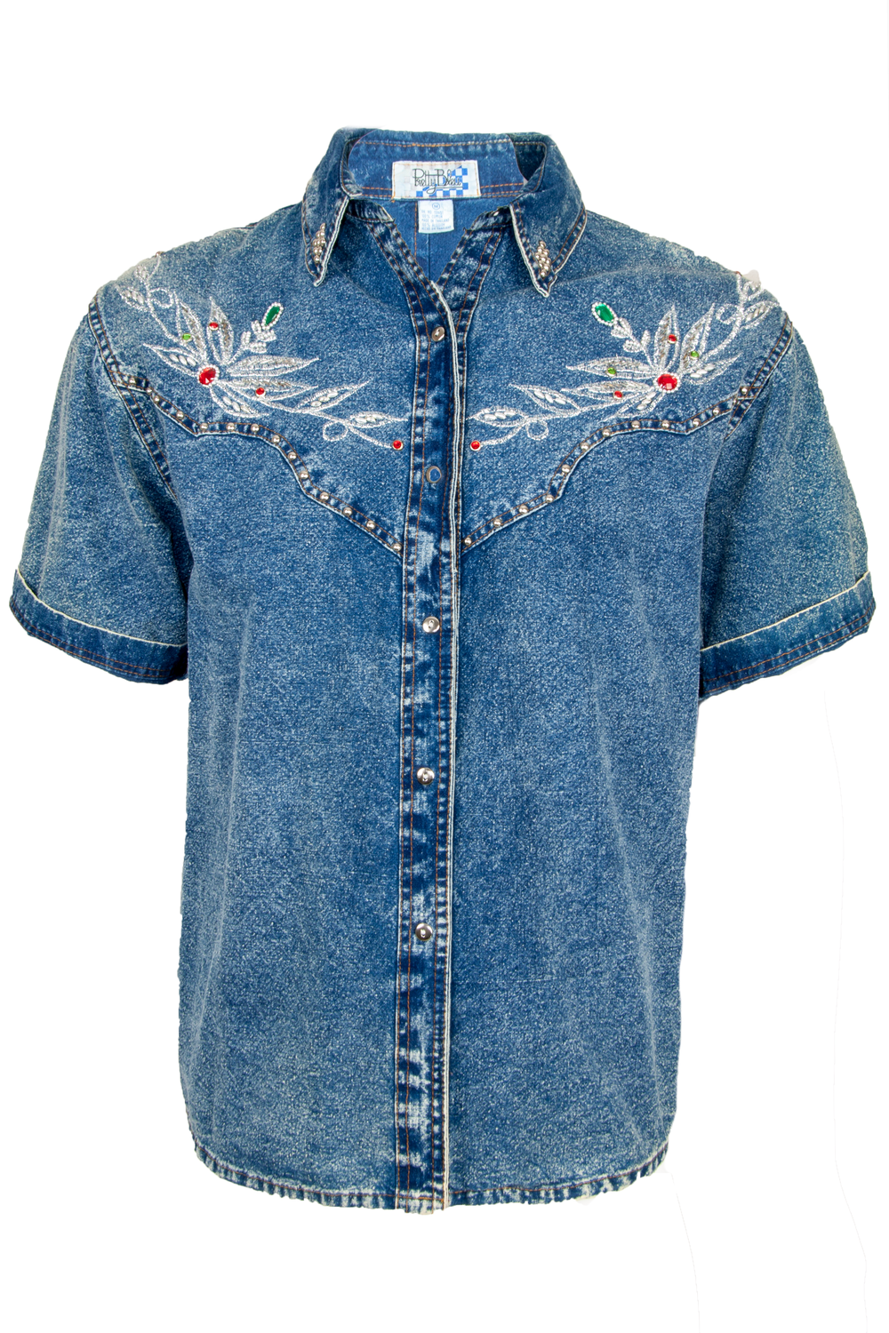 Front view of a vintage textured denim button up with metallic threading at chest silver studding throughout multicolor gems and front button closure.
