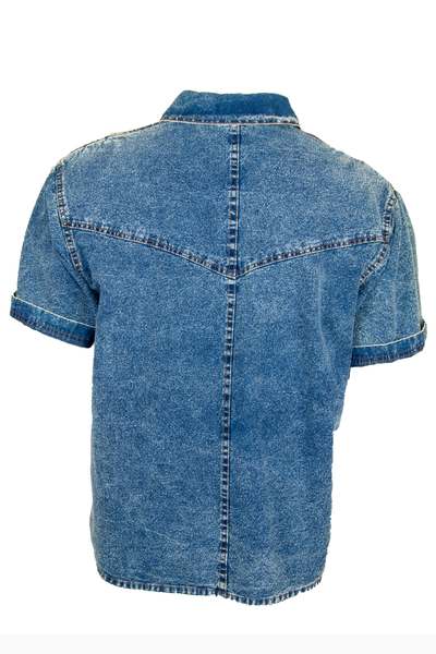 Back view of a vintage textured denim button up with metallic threading at chest silver studding throughout multicolor gems and front button closure.