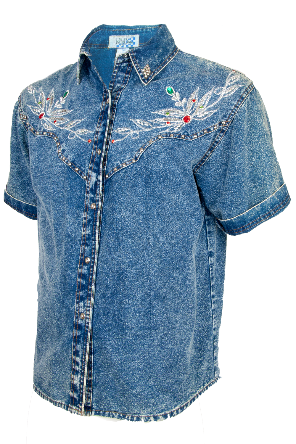 Side view of a vintage textured denim button up with metallic threading at chest silver studding throughout multicolor gems and front button closure.