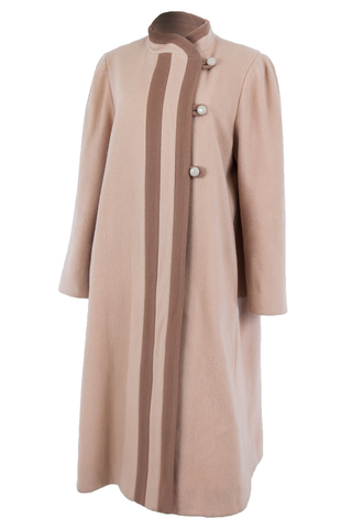 Side view of an American made vintage long length wool camel coat with dusty mauve contrast stripes and buttons.