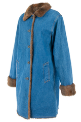 Side view of a vintage long-length denim coat with faux fur collar trim and lining pockets at waist and front button closure.