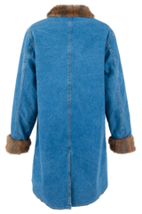 Back view of a vintage long-length denim coat with faux fur collar trim and lining pockets at waist and front button closure.
