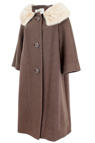 Side view of an American made vintage brown wool overcoat with marbled cream fur trim cropped sleeve and matching mixed texture button closure.
