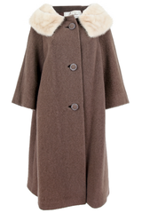 Front view of an American made vintage brown wool overcoat with marbled cream fur trim cropped sleeve and matching mixed texture button closure.