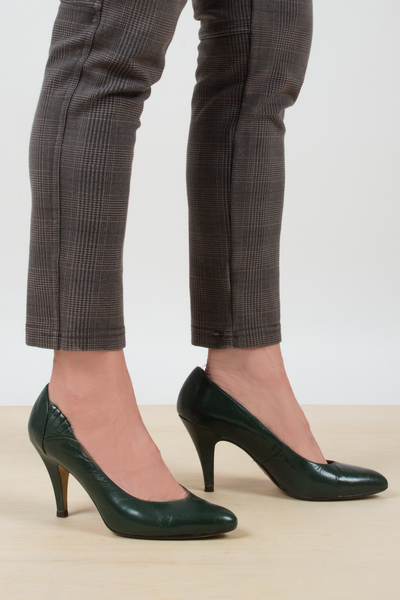 vintage high heel shoes in dark green leather