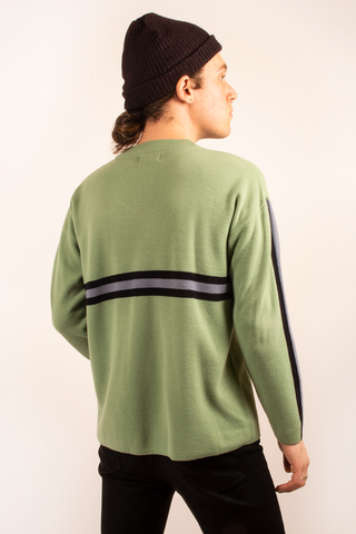 green sweater with tonal stripes