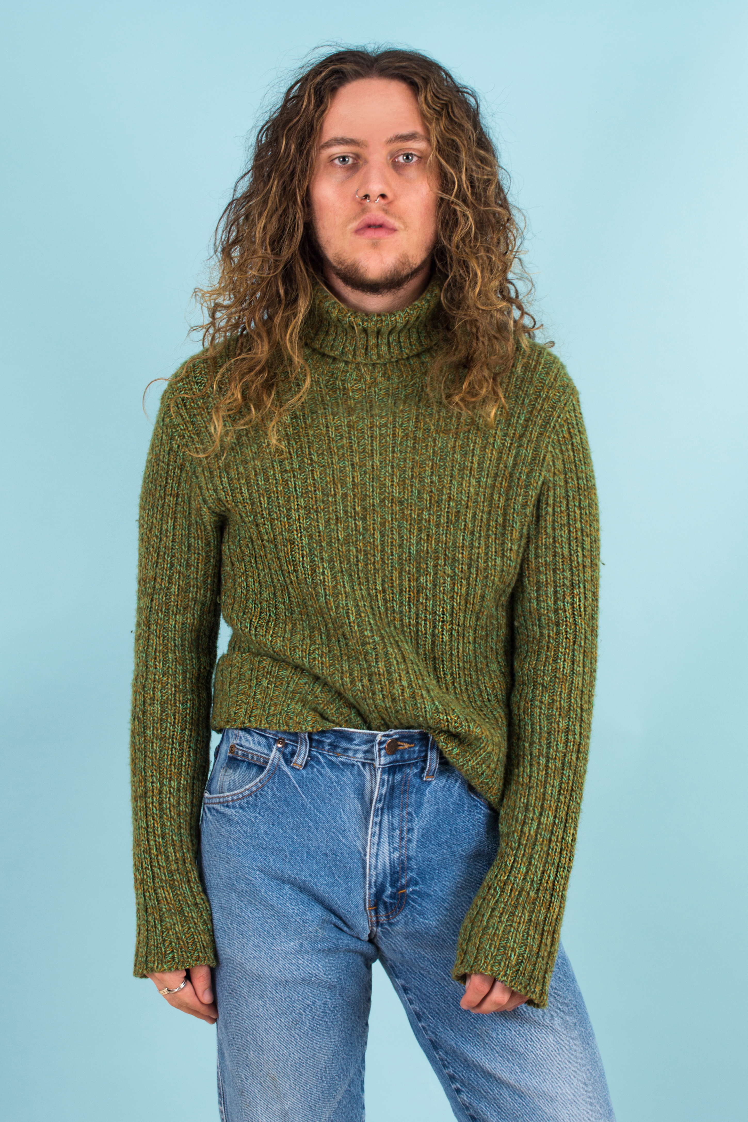vintage green chunky turtleneck sweater and 90s denim
