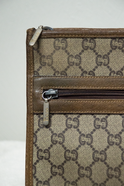 details of a monogramed gucci plus bag