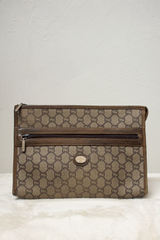 vintage gucci clutch with Gucci Plus monogram