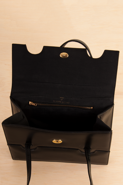inside view of a vintage leather envelope bag in black