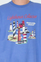 vintage periwinkle sweatshirt with lighthouse graphic