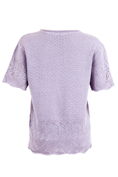Back view of vintage lilac purple knitted shirt featuring intricate cutout pattern short sleeves and crewneck.