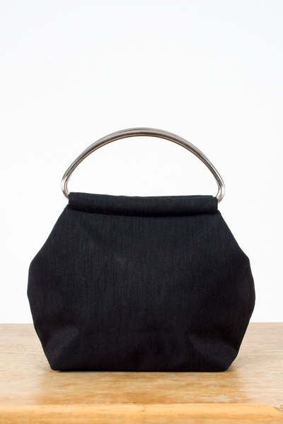vintage black fabric handbag with metal handle