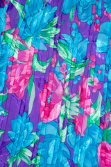 metallic floral print in purple, pink, and blue