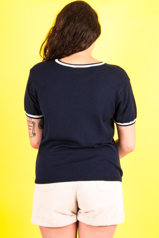 vintage navy blue short sleeve sweater and 90s white denim shorts