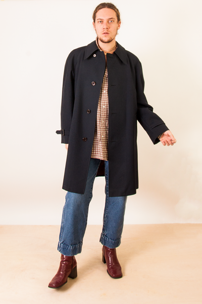 vintage blue trench coat, wide leg jeans, and brown flannel