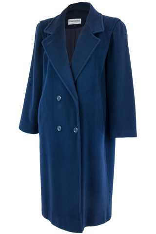 Side view of American made vintage navy blue double-breasted wool overcoat with lapel collar and pockets at hip.