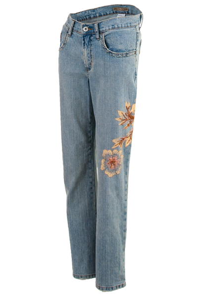 faded blue jeans with painted flowers