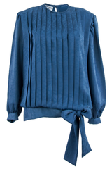 blue pleated shirt with bow tie at hip
