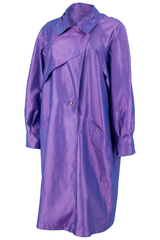 Iridescent purple vintage trench coat with wide lapel, pockets at hip, and front button closure.