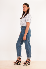 vintage blue jeans with daisy sandals and polka dot shirt