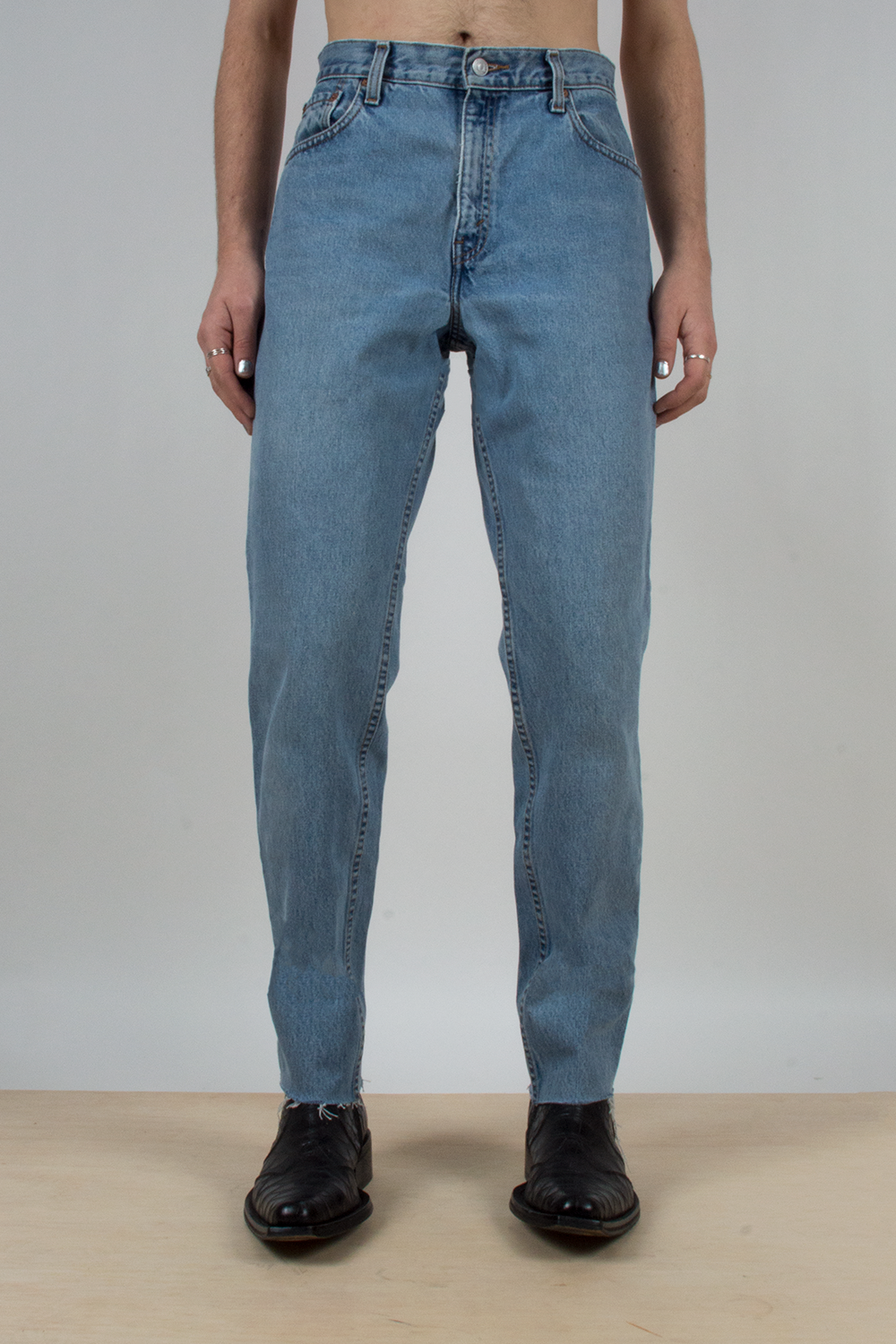 vintage blue Levi's 550 with cut hem