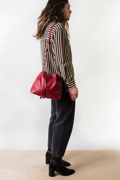 red leather vintage bucket bag with crossbody strap