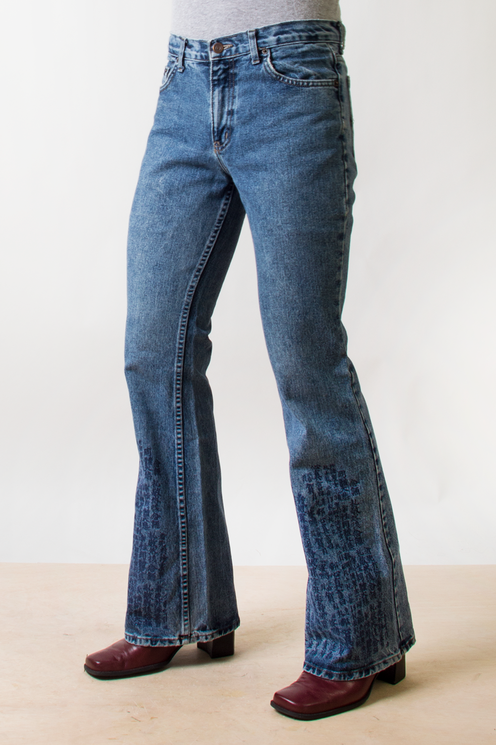 vintage flared jeans with asian scripture at bottom