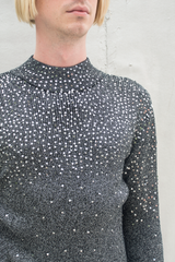 detail of a grey sequin vintage sweater