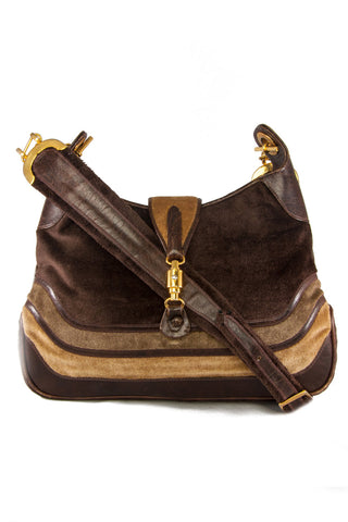 Brown vintage purse featuring velour with leather stripes and gold-tone hardware