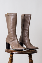 vintage taupe leather boots with a gold buckle